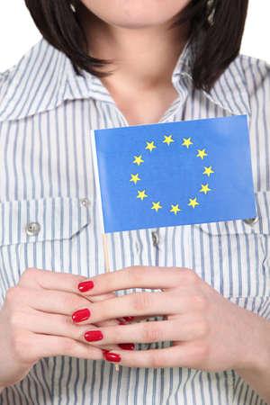 unification: Woman holding an EU flag Stock Photo