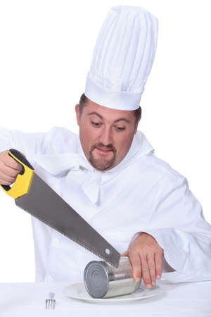 teary: Chef sawing tin Stock Photo