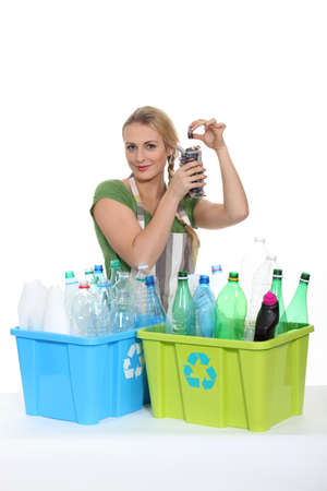 Woman recycling old plastic bottles Stock Photo - 13645450
