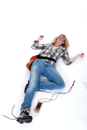 electric current: Female electrician suffering an electric shock