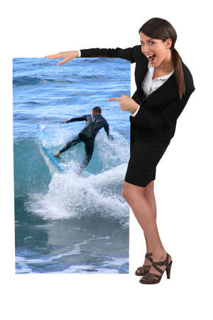 exhilarated: Women pointing at poster Stock Photo
