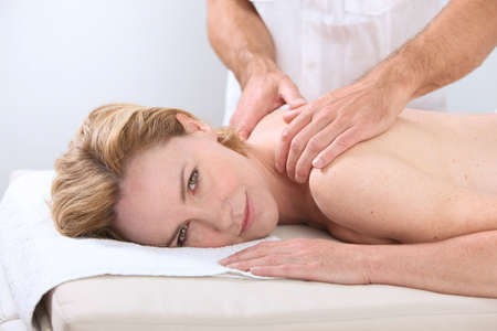 back rub: Woman having a massage