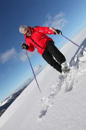 Mature man skiing photo
