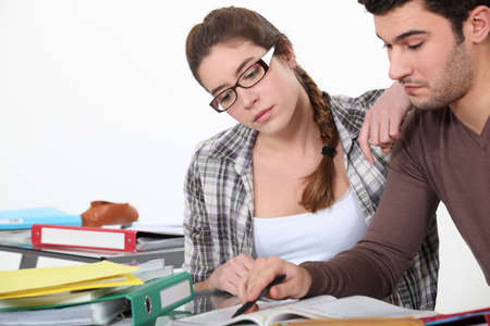 revising: Couple revising together Stock Photo