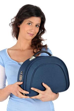 Woman holding an overnight bag Stock Photo - 13645837