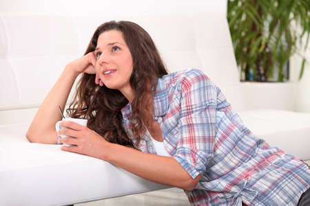 Woman relaxing with a cuppa Stock Photo - 13645842