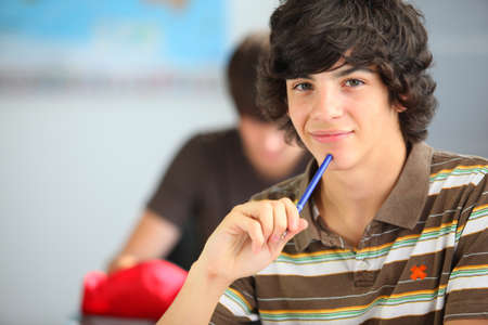 middle school: A teenage boy in the classroom