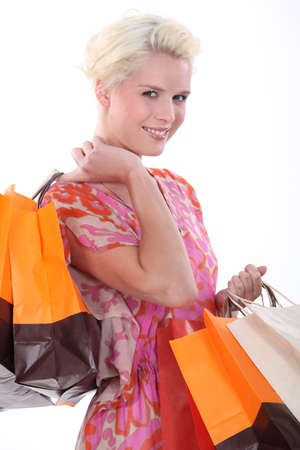 laden: Young woman laden with store bags Stock Photo