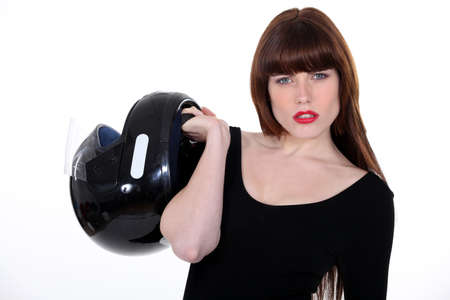 Attractive woman carrying a motorcycle helmet photo
