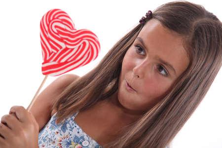 little girl surprised: portrait of a little girl with lollipop