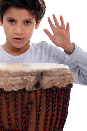 bongo drum: Little boy with bongo drum Stock Photo