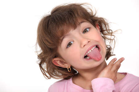 silly: Little girl sticking tongue out Stock Photo
