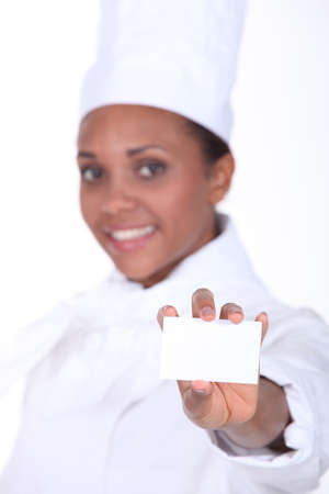 Chef holding a businesscard Stock Photo - 13645451