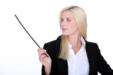 designate: Pretty young woman in black suit holding stick