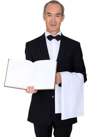 log book: A waiter with a blank book Stock Photo
