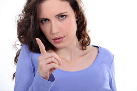 wagging: Woman wagging her finger Stock Photo