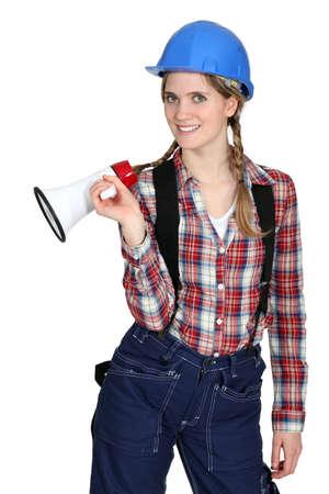Tradeswoman holding a megaphone photo
