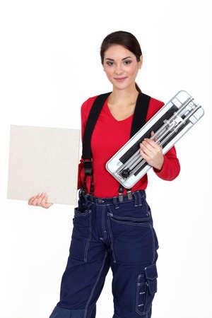 craftswoman: craftswoman holding a tile