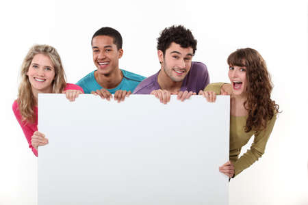 group of friends holding a blank poster photo