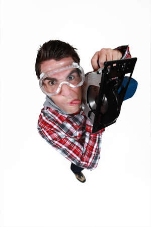 crazy craftsman sticking his tongue out Stock Photo - 13645486