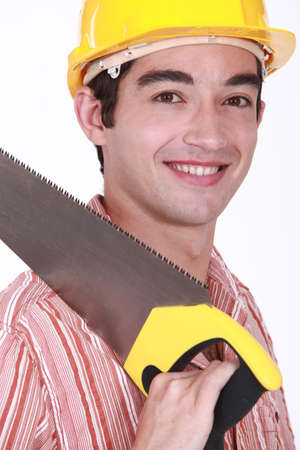 Young carpenter holding hand-saw photo