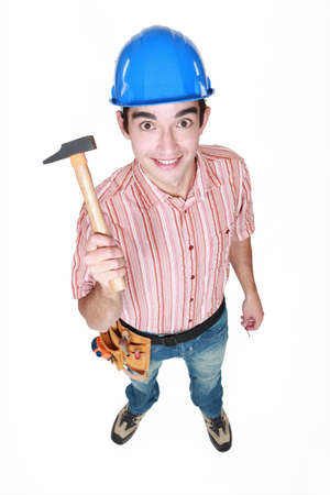 Happy worker holding hammer photo