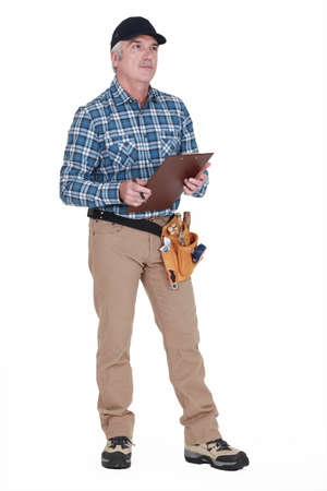 Carpenter with a clipboard Stock Photo - 13645540