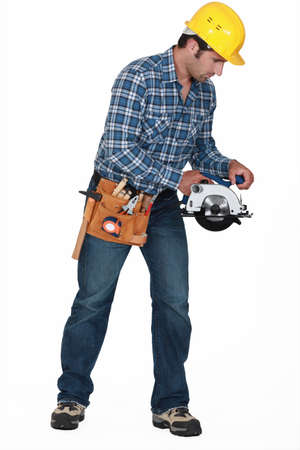 electric drill: Construction worker with a disc cutter Stock Photo