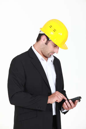 Man with helmet and cell phone photo