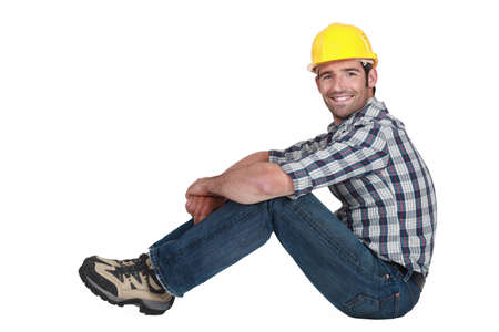 A handsome manual worker seated  photo