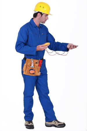 ohm: Electrician with an multi-meter Stock Photo