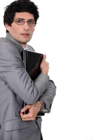 cagey: Businessman clutching his laptop