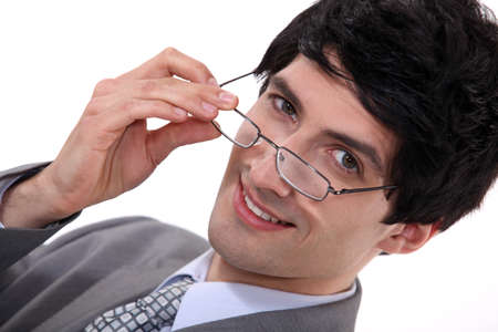 perceptive: Businessman peering over his glasses