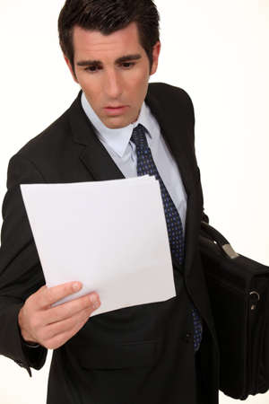 Shocked businessman reading document Stock Photo - 13645646