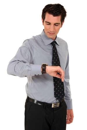 men 45 years: Businessman looking at the time Stock Photo