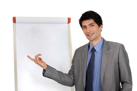 handsome executive pointing at board photo