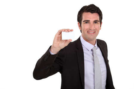 Businessman holding up his business card Stock Photo - 13645377
