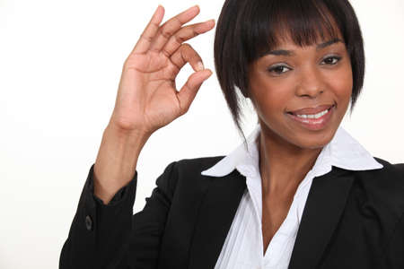 ok hand: An African American businesswoman gesturing an ok sign