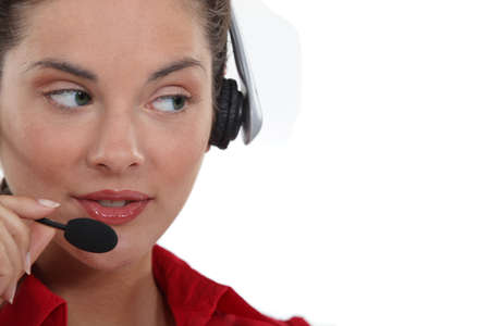 Woman speaking into her headset photo