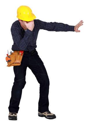 Laborer gesturing on white background photo