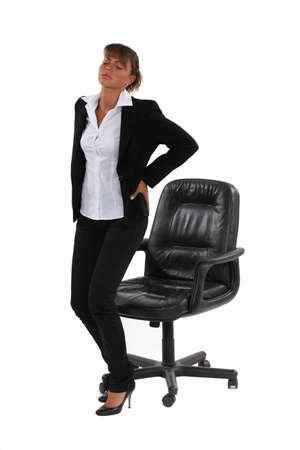 Businesswoman with back ache photo