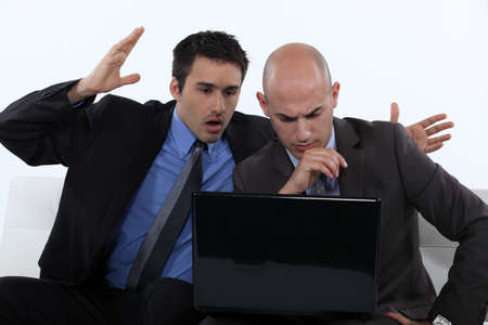 horrifying: Two stressed office worker with laptop