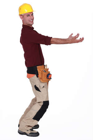 invisible object: Tradesman carrying an invisible object Stock Photo