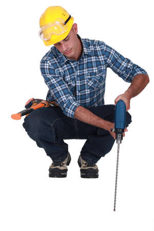 Man drilling into floor photo