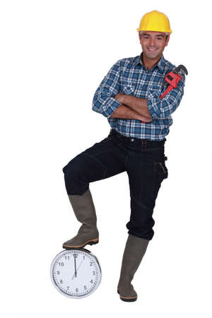 tradesperson: Tradesman with his foot propped on a clock