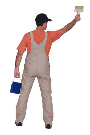 Handyman painting, back view Stock Photo - 13645419