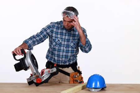 craftsman looking at his new electric saw photo
