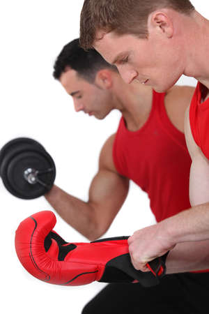 men exercising: Men working out at the gym Stock Photo