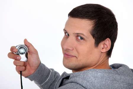 chronograph: Man holding stop watch Stock Photo