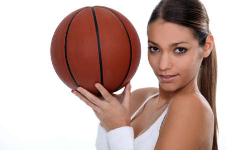 baloncesto chica: mujer jugando al baloncesto Foto de archivo